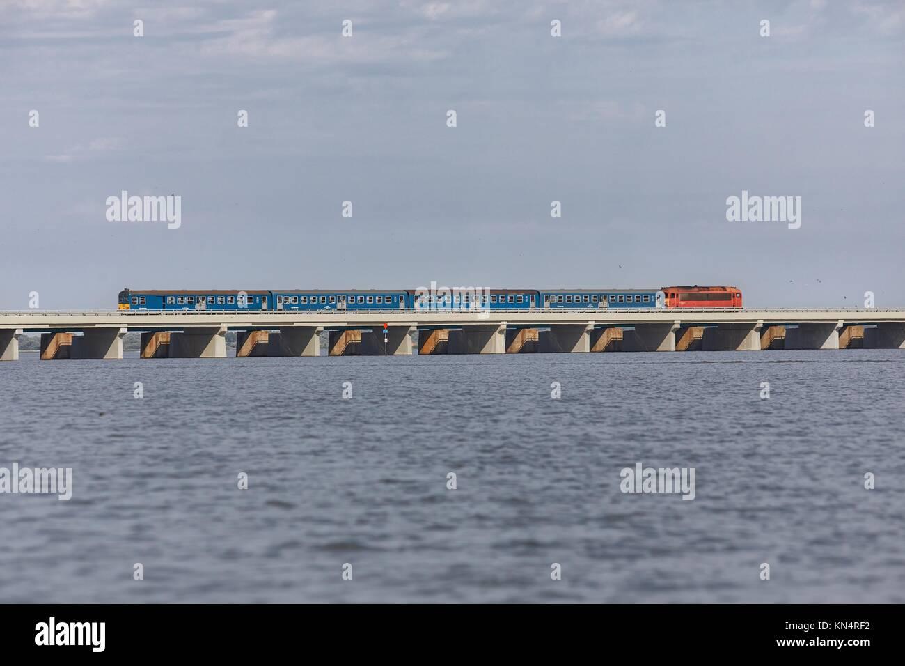 Train over a lake Stock Photo