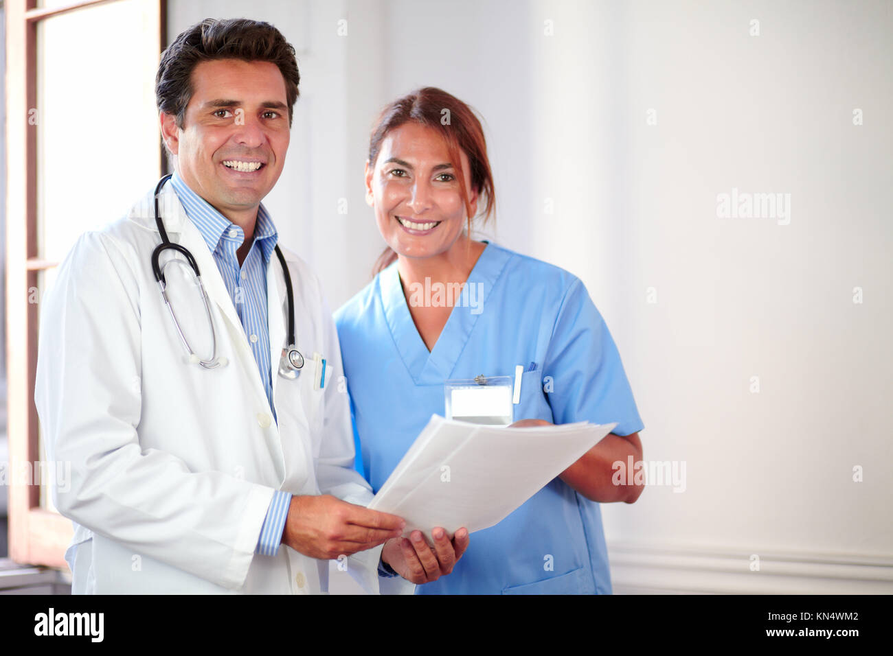 Portrait of a medical colleagues looking and smiling at you while holding documents - copyspace. - Stock Image