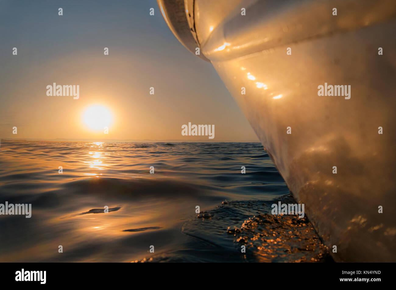 Boat sailing towars the sunset, by the sea of cortes near La Paz Baja California Sur Mexico Stock Photo