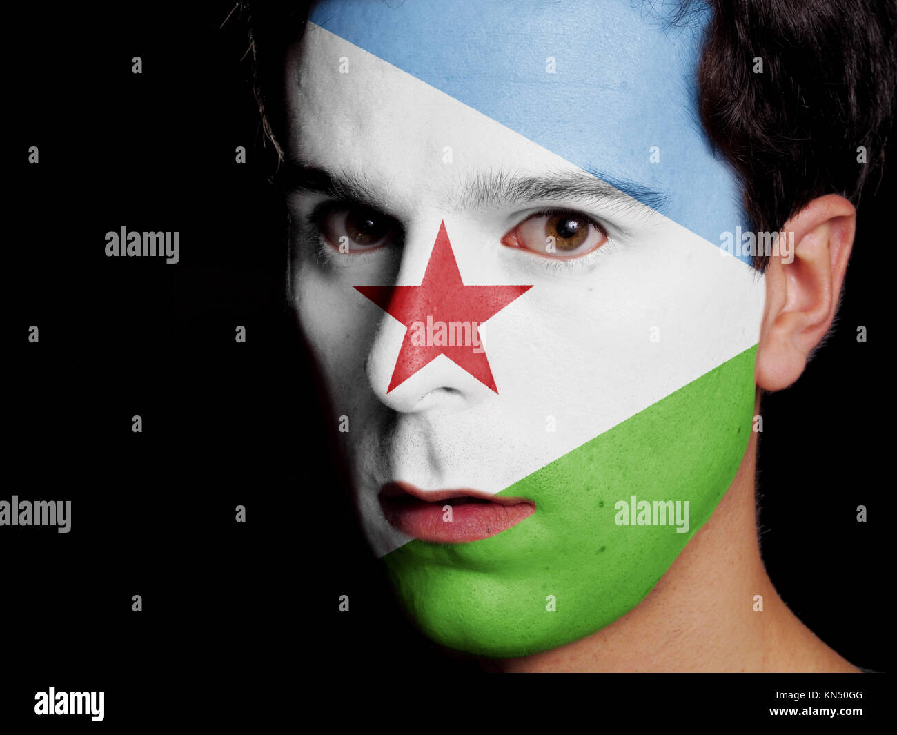 Flag of Djibouti Painted on a Face of a Young Man. - Stock Image