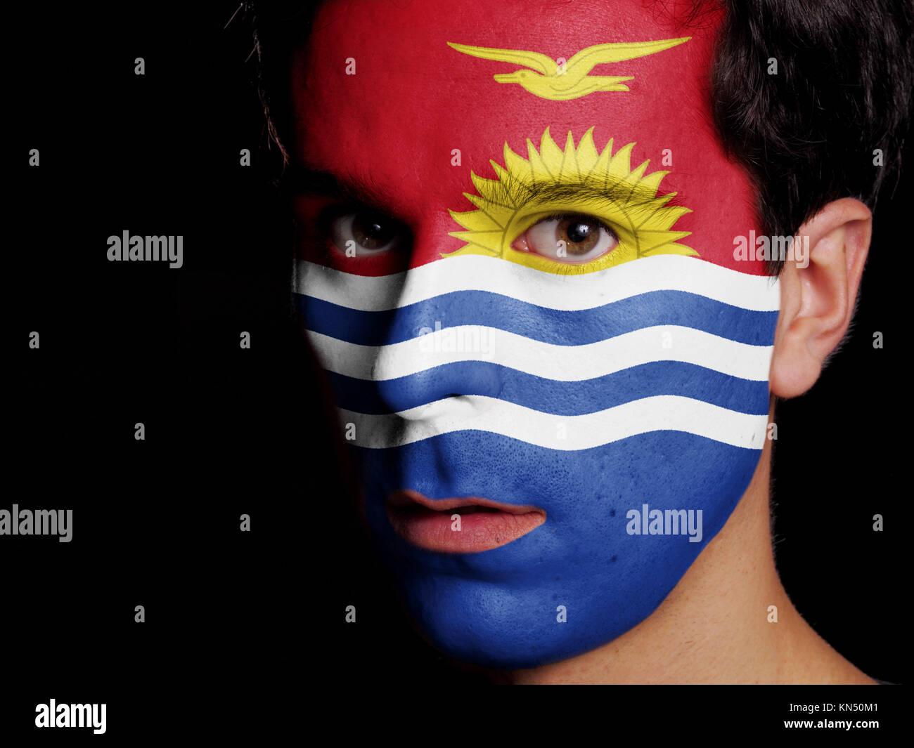 Flag of Kiribati Painted on a Face of a Young Man. - Stock Image