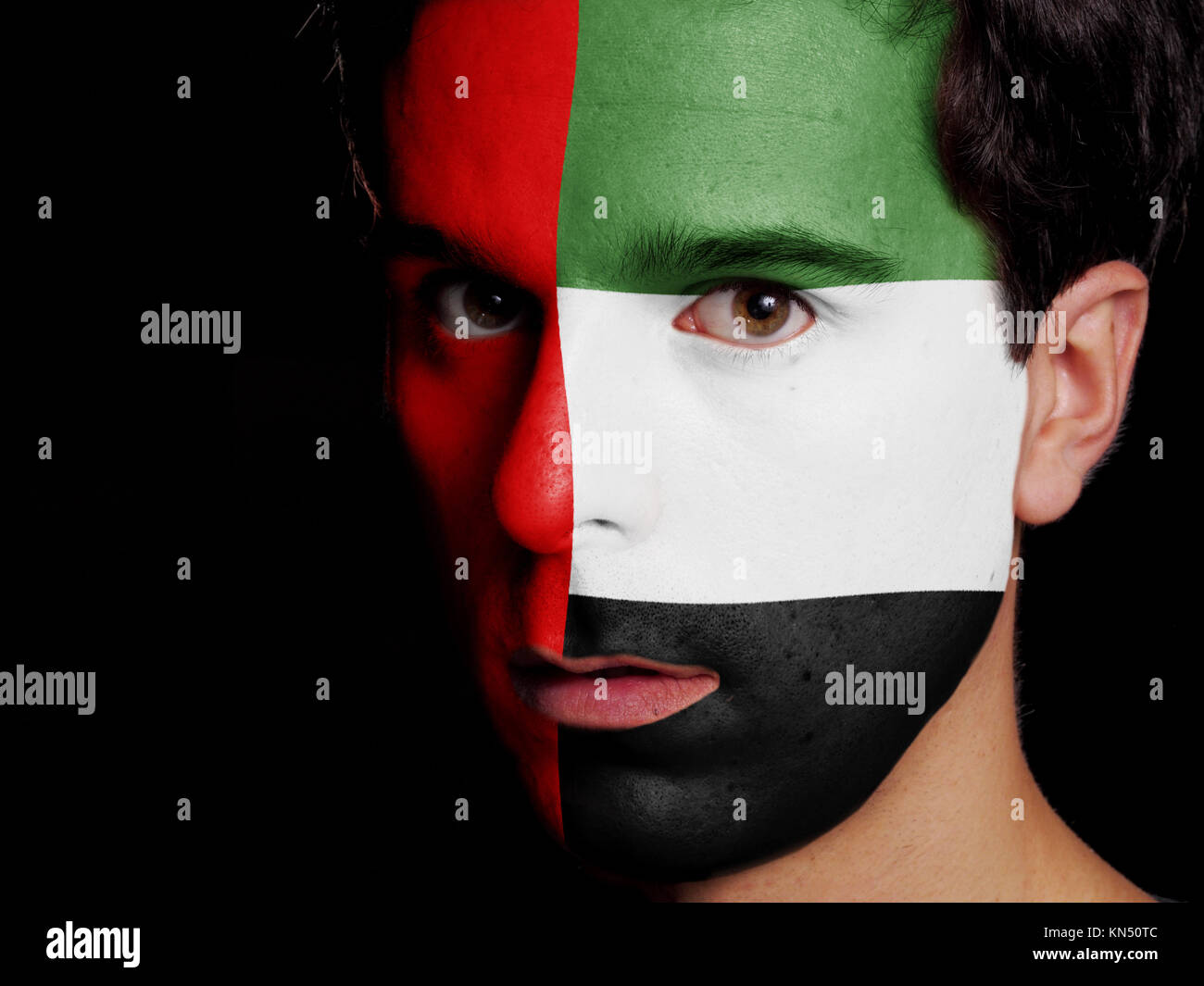 Flag of United Arab Emirates Painted on a Face of a Young Man. Stock Photo