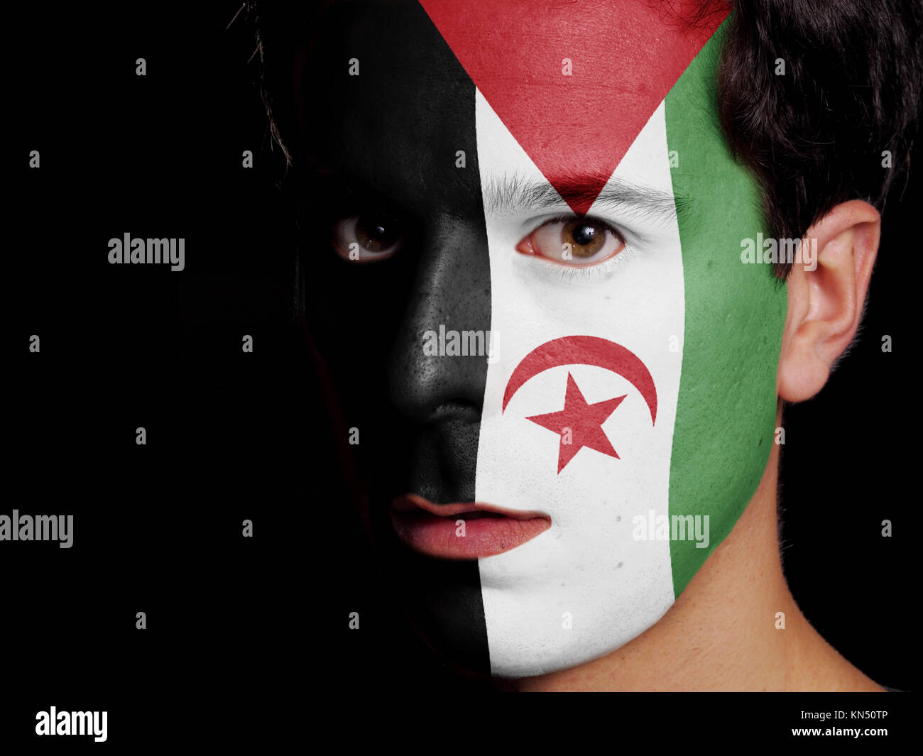 Flag of Sahrawi Arab Democratic Republic Painted on a Face of a Young Man. - Stock Image