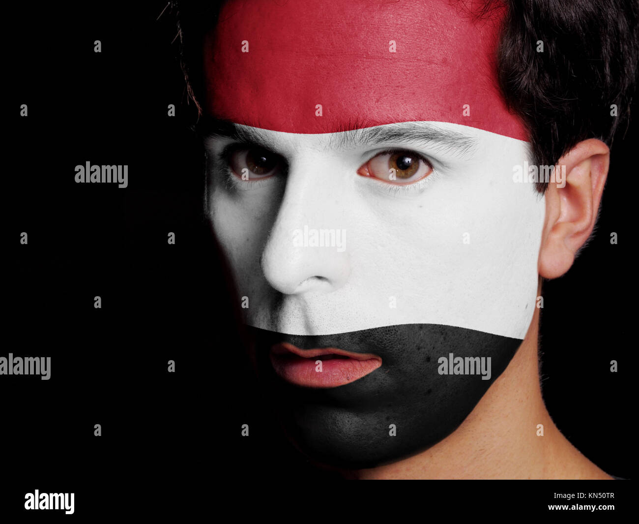 Flag of Yemen Painted on a Face of a Young Man. - Stock Image