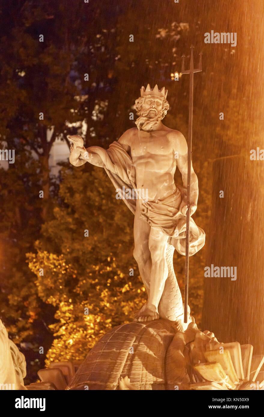 Neptune with Trident Snake, Roman God, Statue Fountain Night Plaza Canovas del Castillo Madrid Spain. Neptune Statue - Stock Image