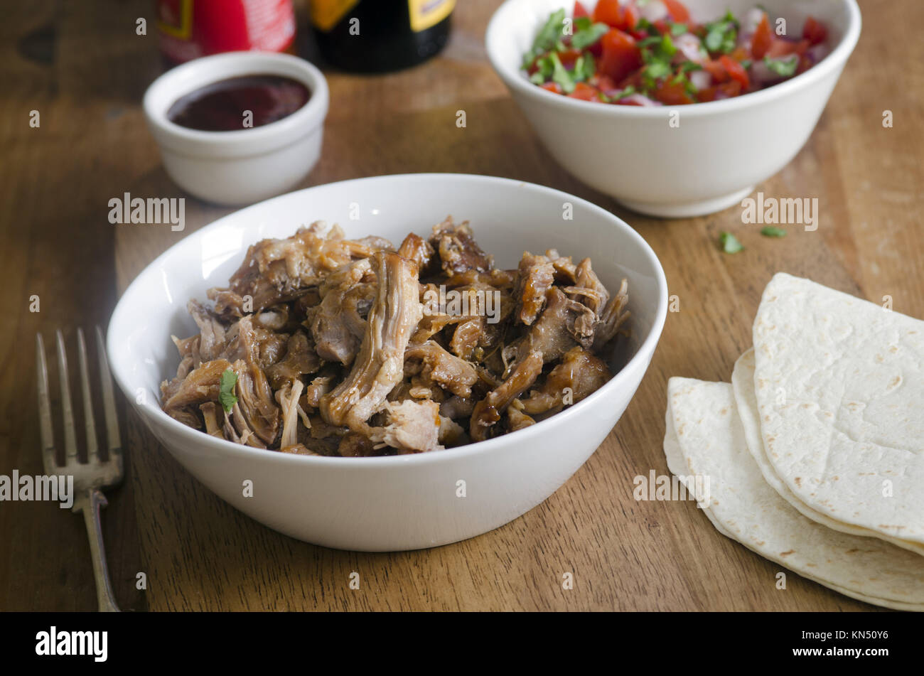 Slow-cooker chipotle pulled pork with salsa. - Stock Image