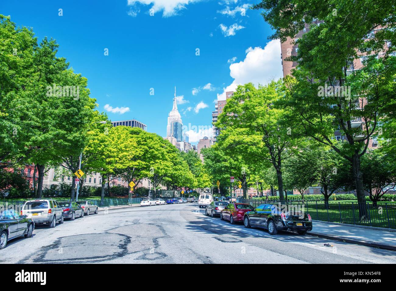 Beutiful view of New York skyline and avenue from Chelsea Park area - Manhattan in summer season. Stock Photo