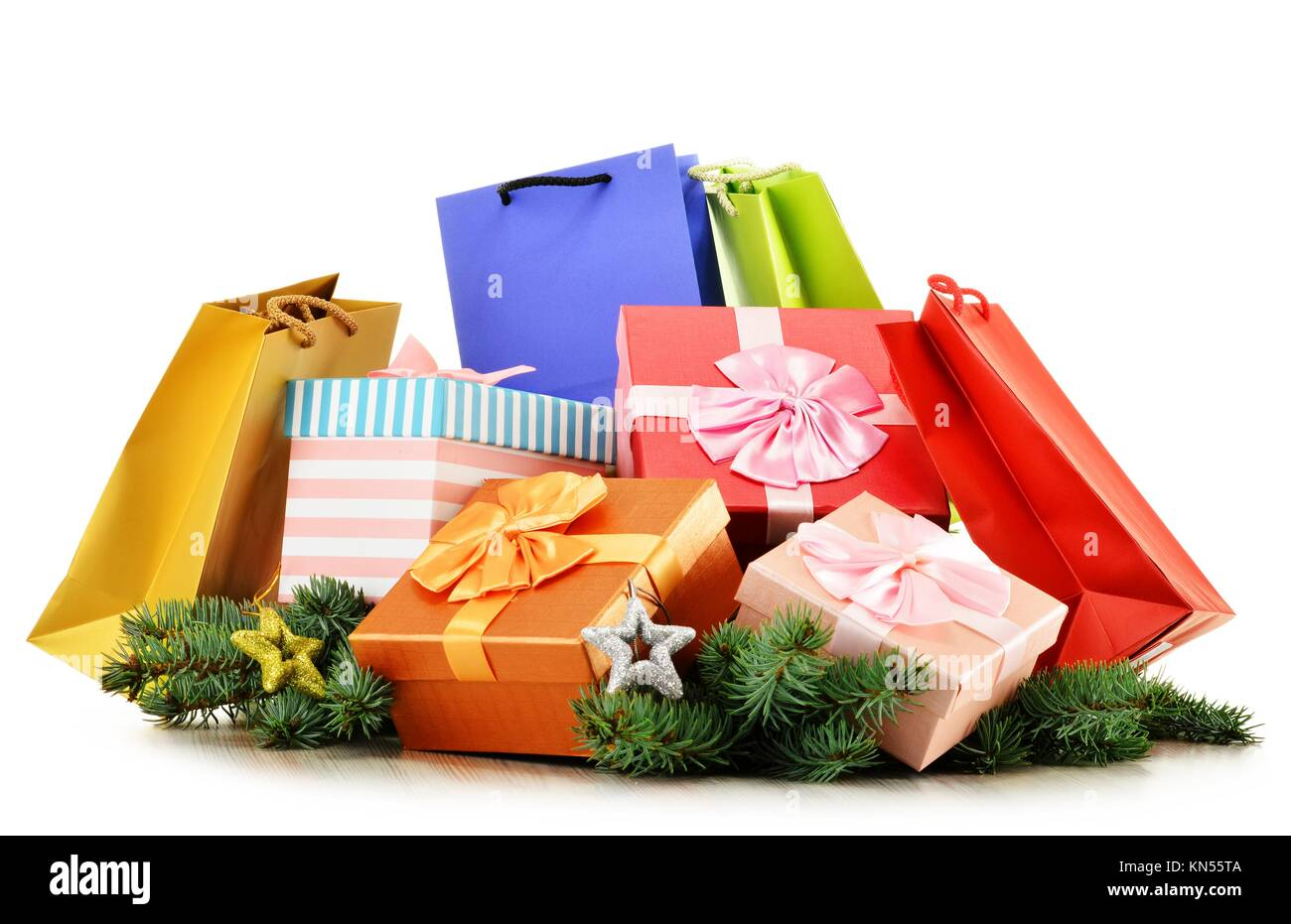 Colorful gift boxes and paper bags isolated on white background. Stock Photo