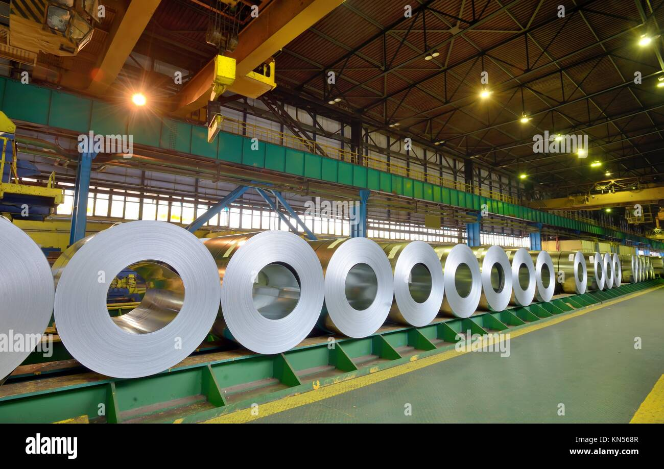 rolls of steel sheet in a plant, galvanized steel coil. - Stock Image