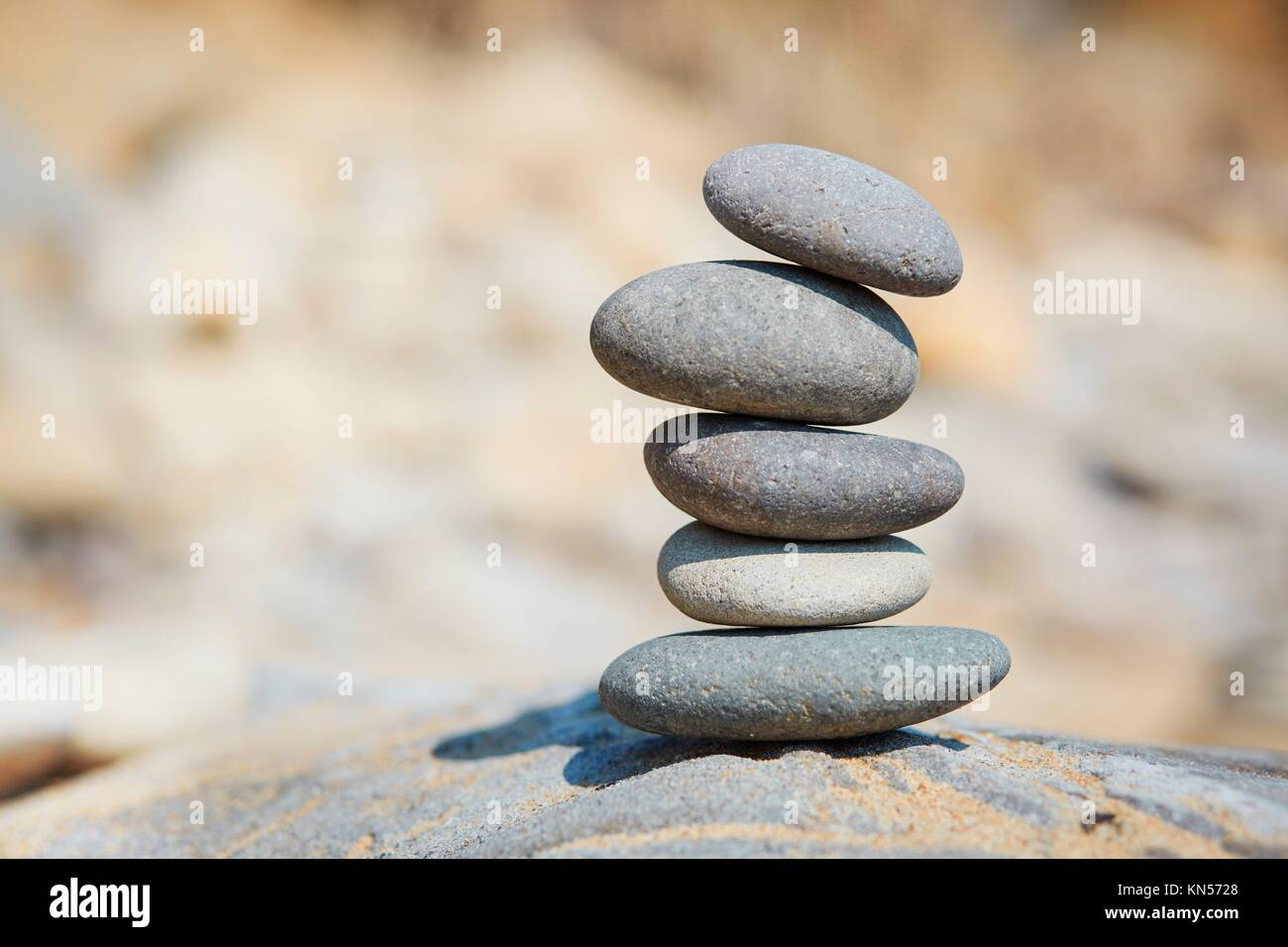 Stone composition on the beach. - Stock Image