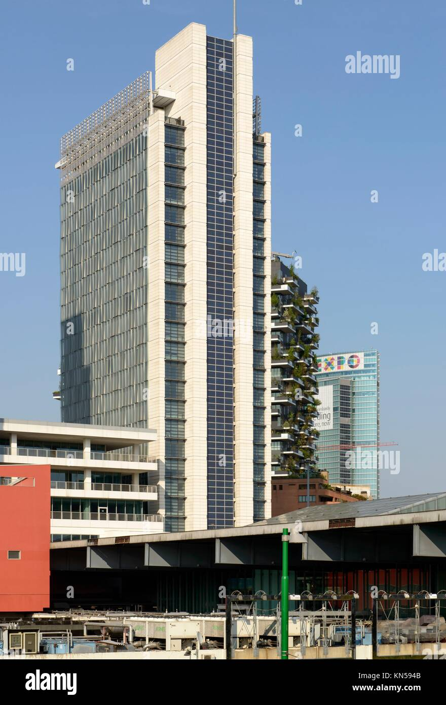 MILAN, ITALY - APRIL 11: foreshortening of tall buildings and, in background, Regione Lombardia building with EXPO - Stock Image