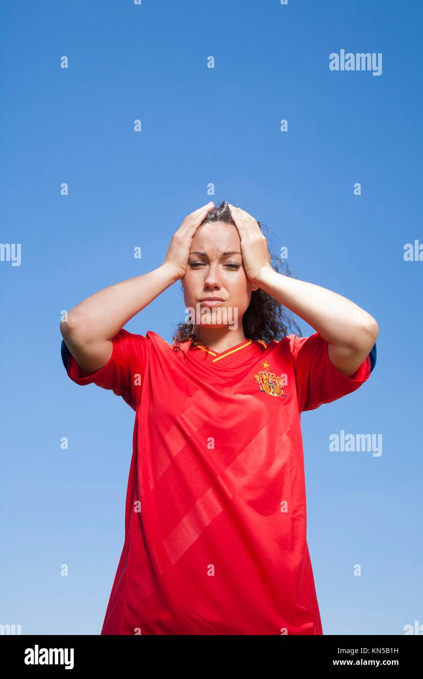 woman with red spanish soccer team shirt loser face. - Stock Image