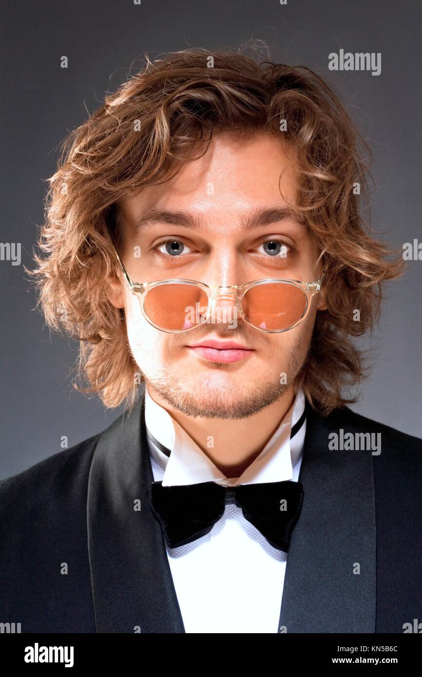 Portrait of a Young Man with Glsses in Tuxedo. - Stock Image