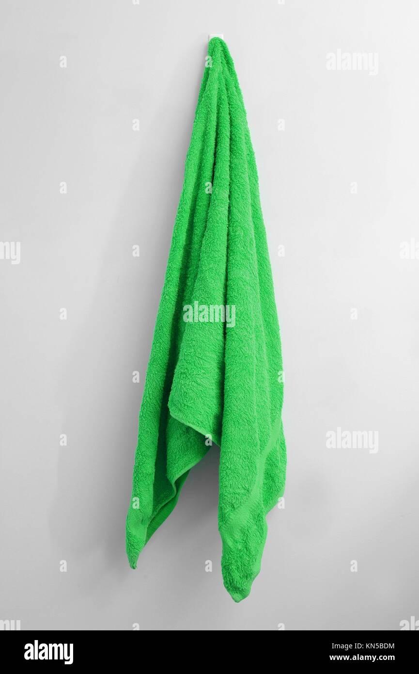 A close up shot of a towel hanging. - Stock Image