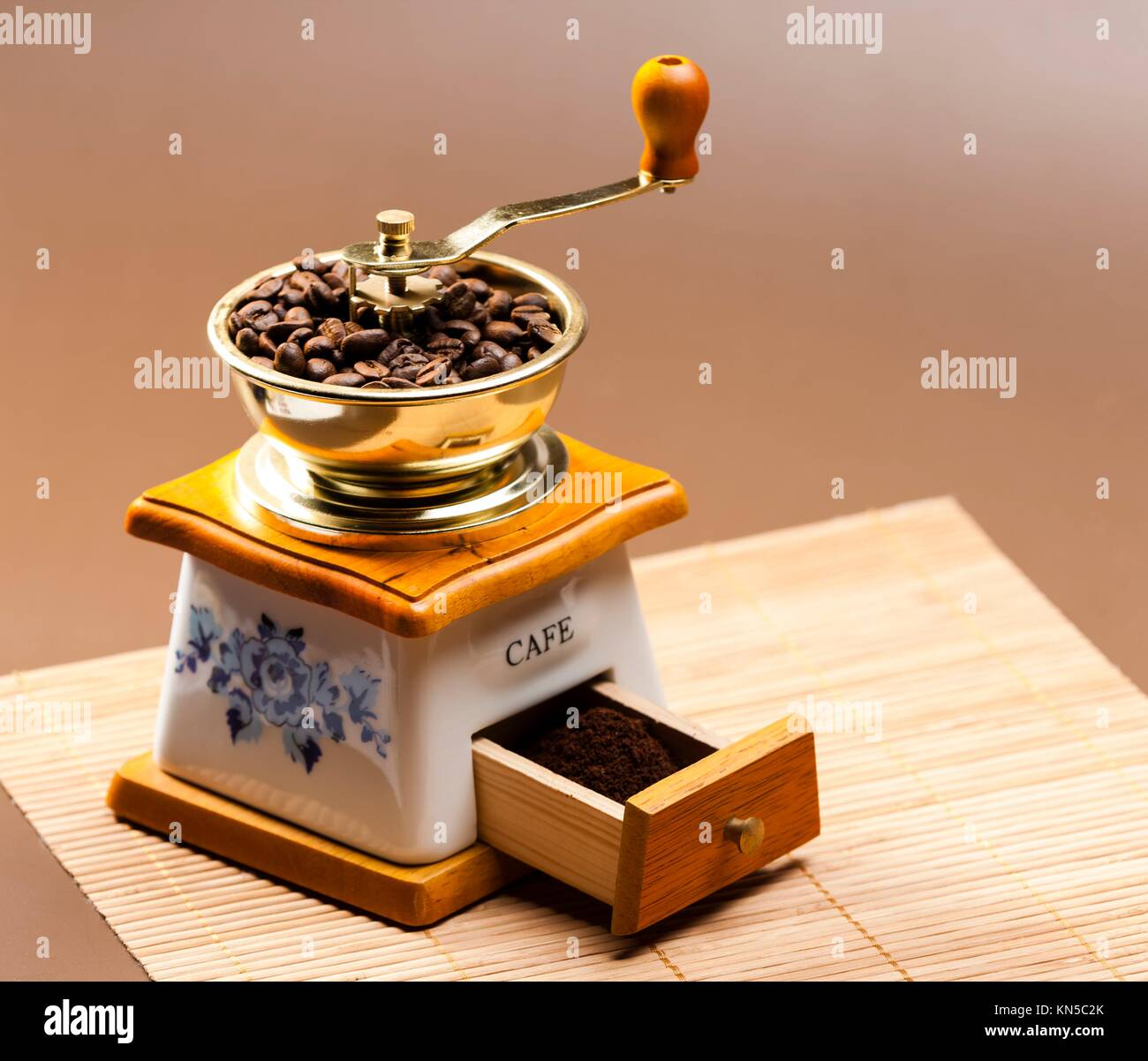 coffee mill with coffee beans. - Stock Image