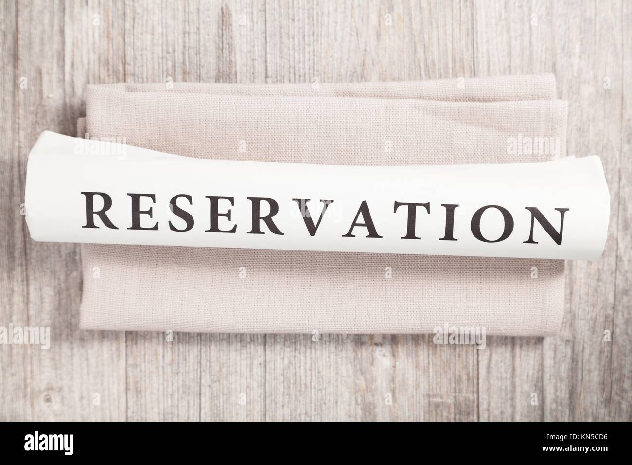 reservation written on a newspaper. - Stock Image