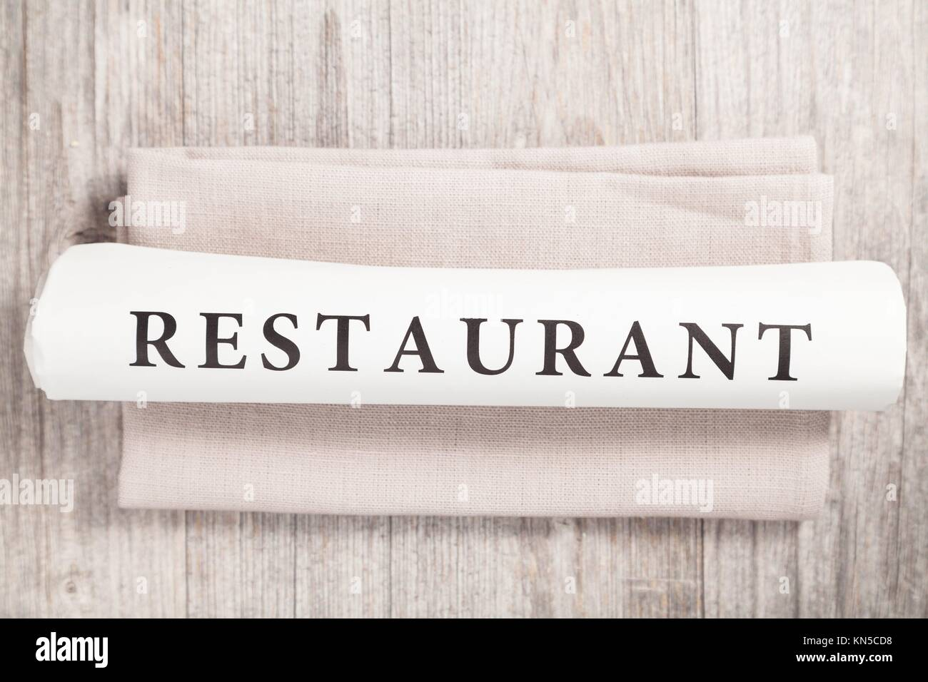 restaurant written on a newspaper. - Stock Image