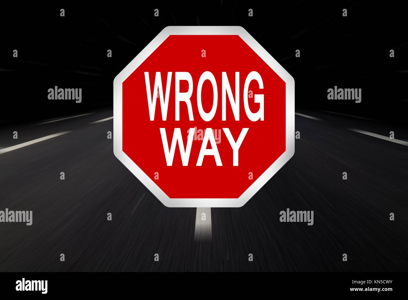 wrong way written on traffic sign. - Stock Image
