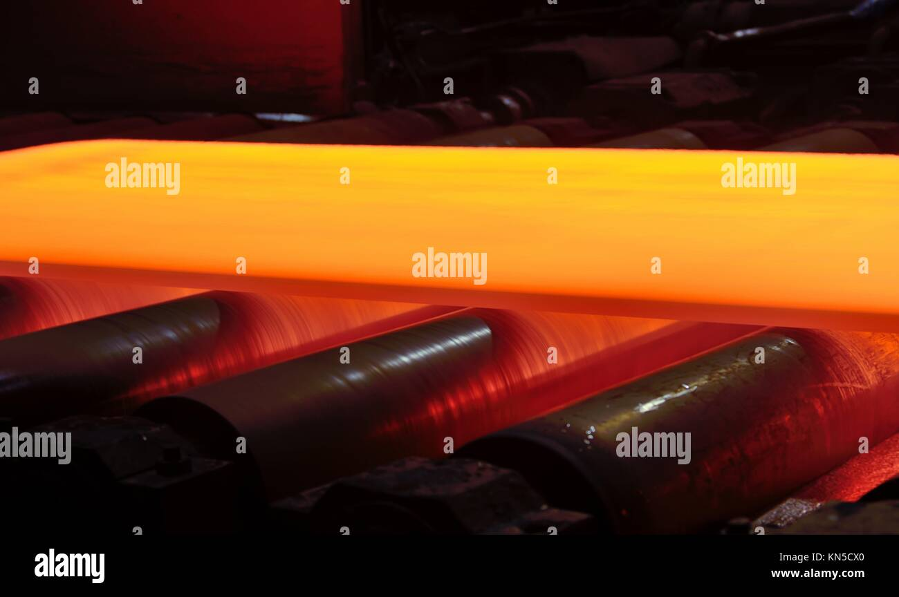 steel plate on conveyor inside of plant. Stock Photo