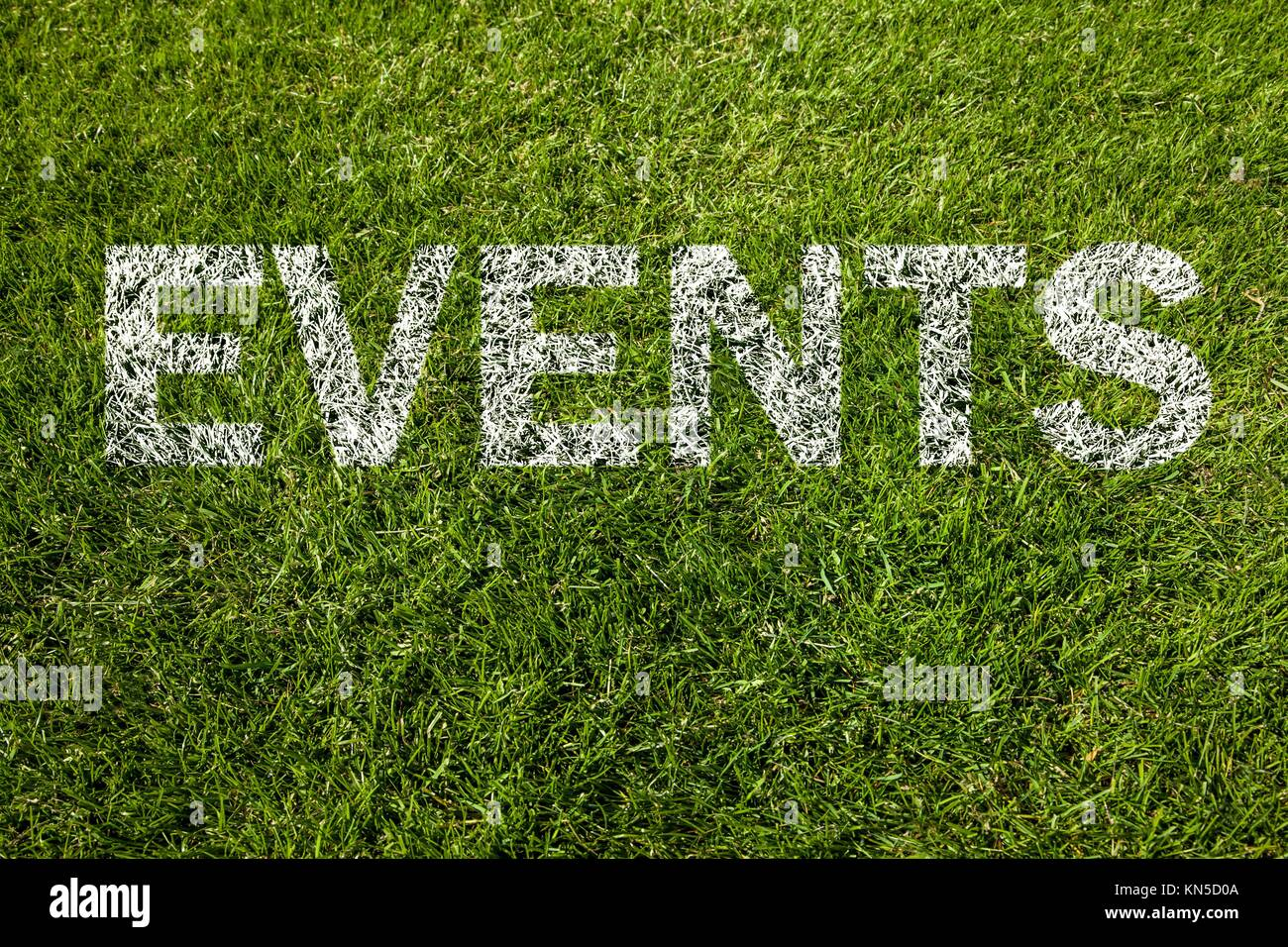 events text written on grass. - Stock Image