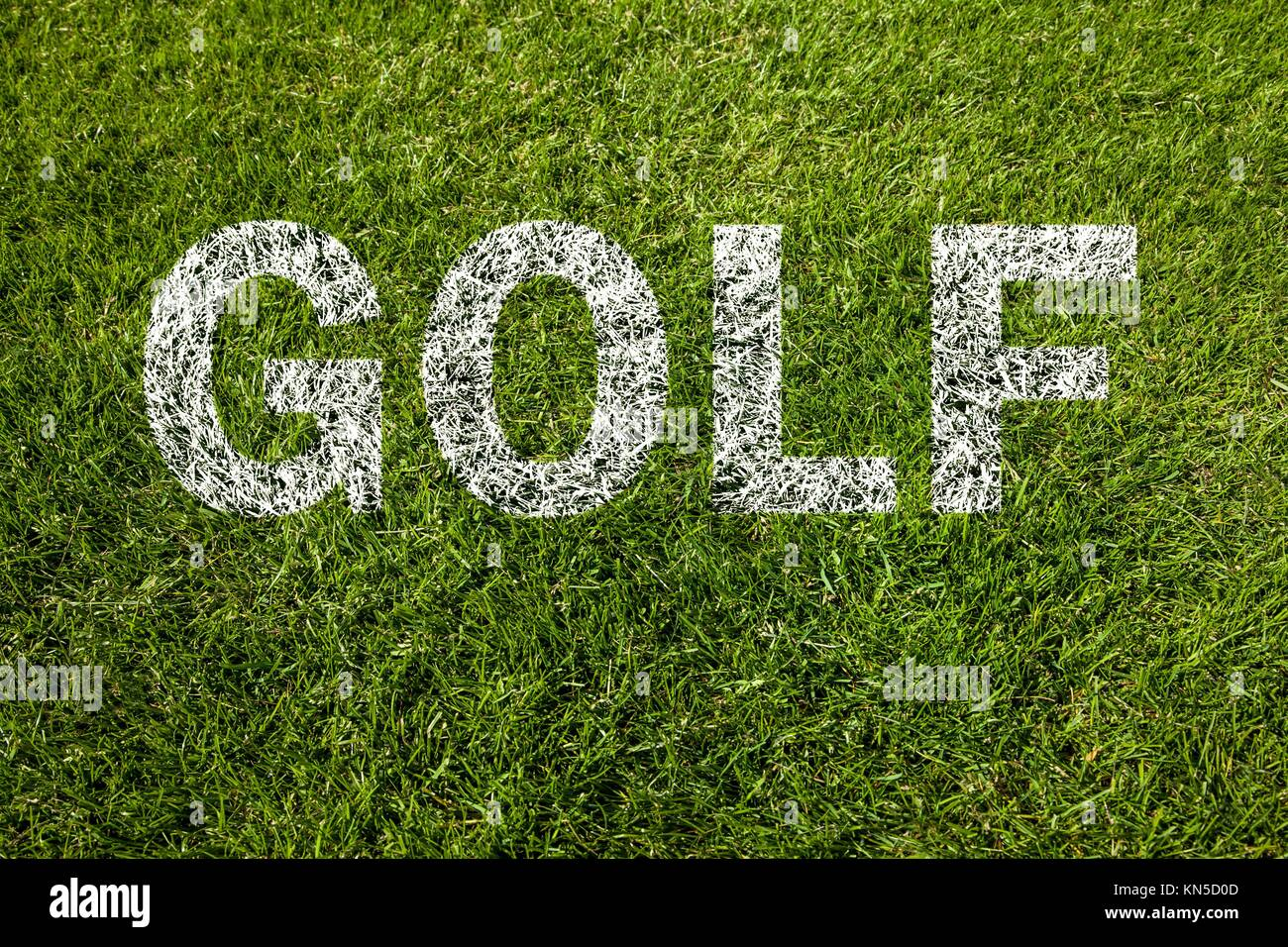 golf written on green grass. - Stock Image