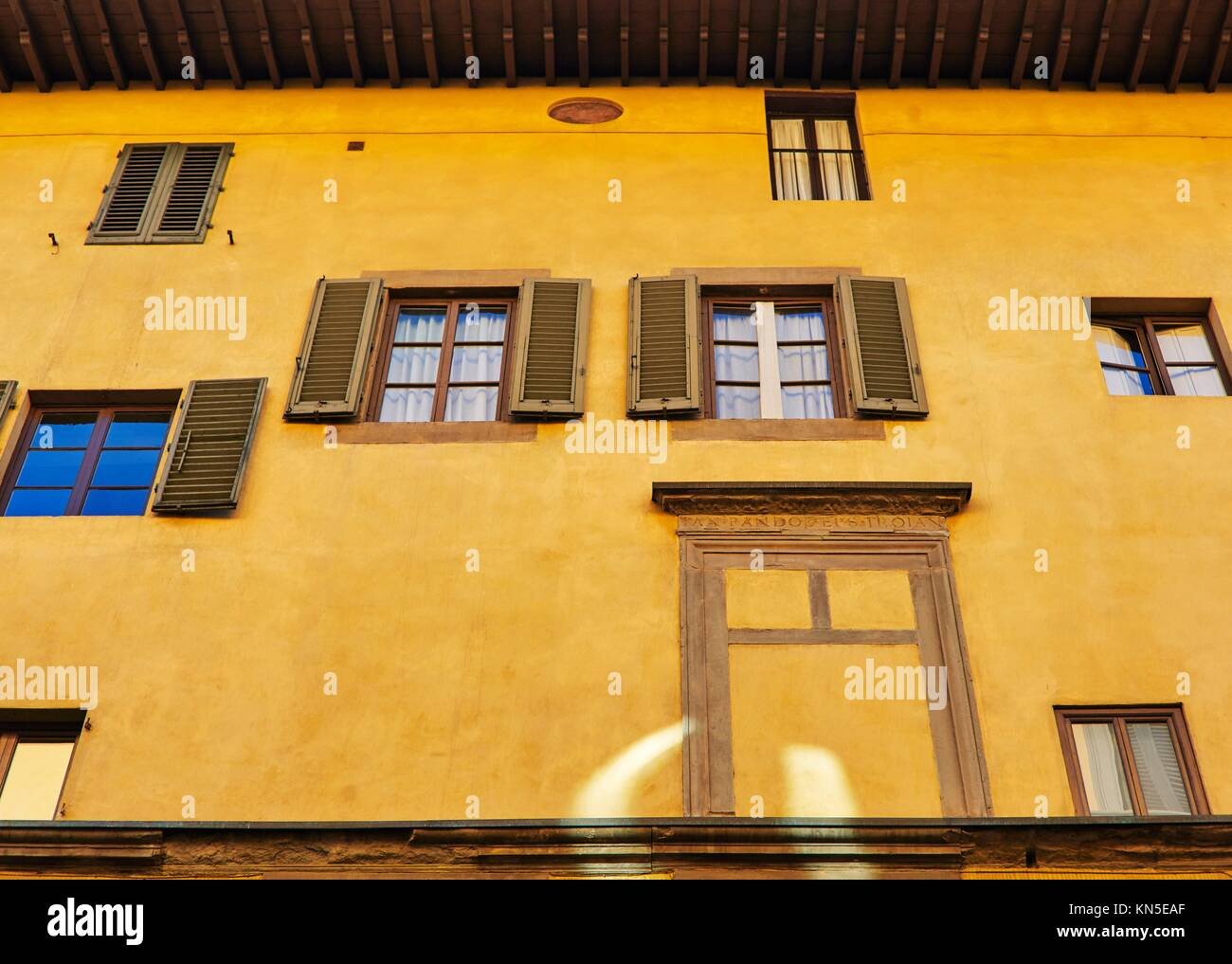 Florentine building facade with different windows. - Stock Image
