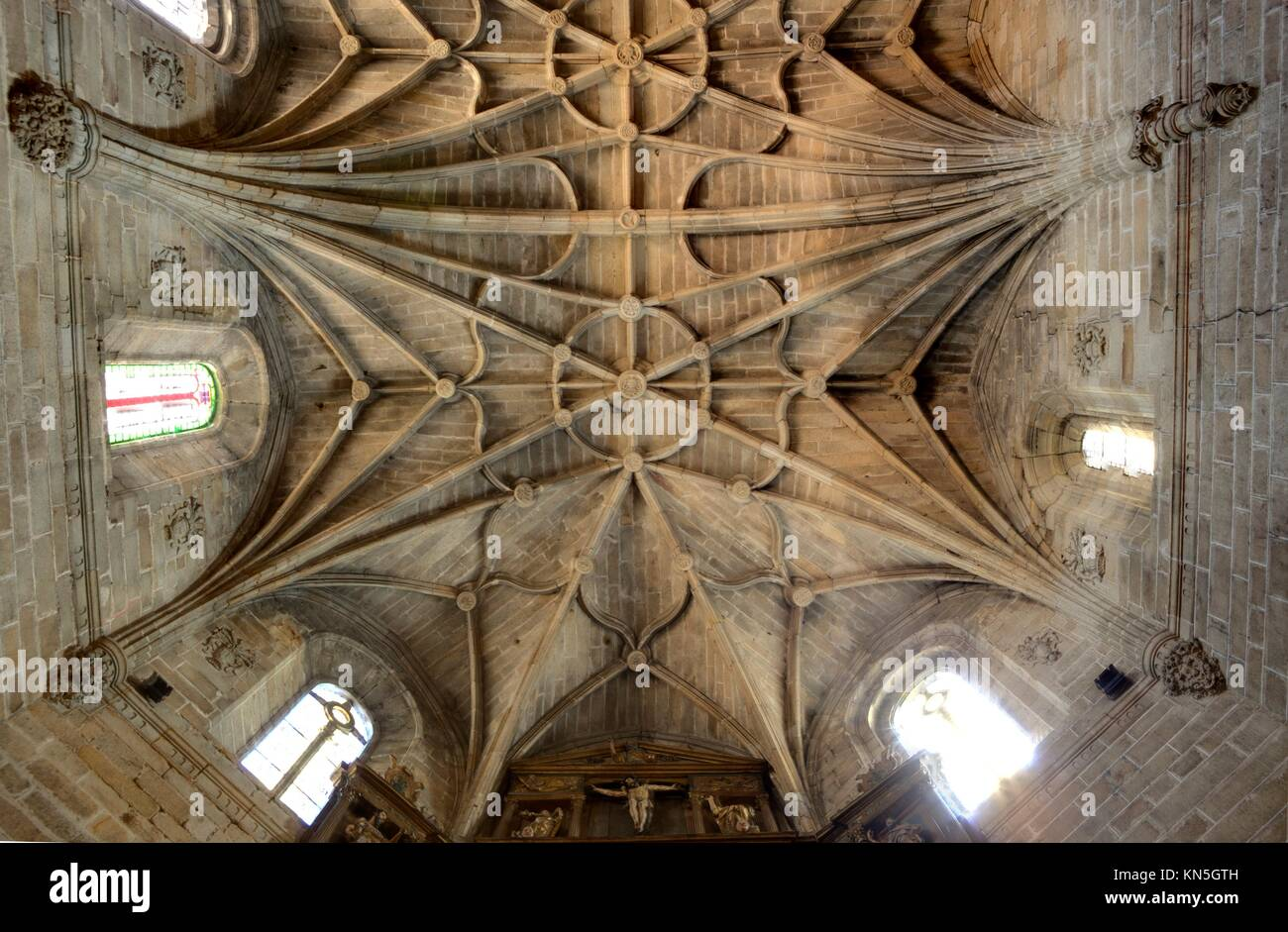 Typcal Gothic cross vault made of granite stone, Caceres, Spain. - Stock Image