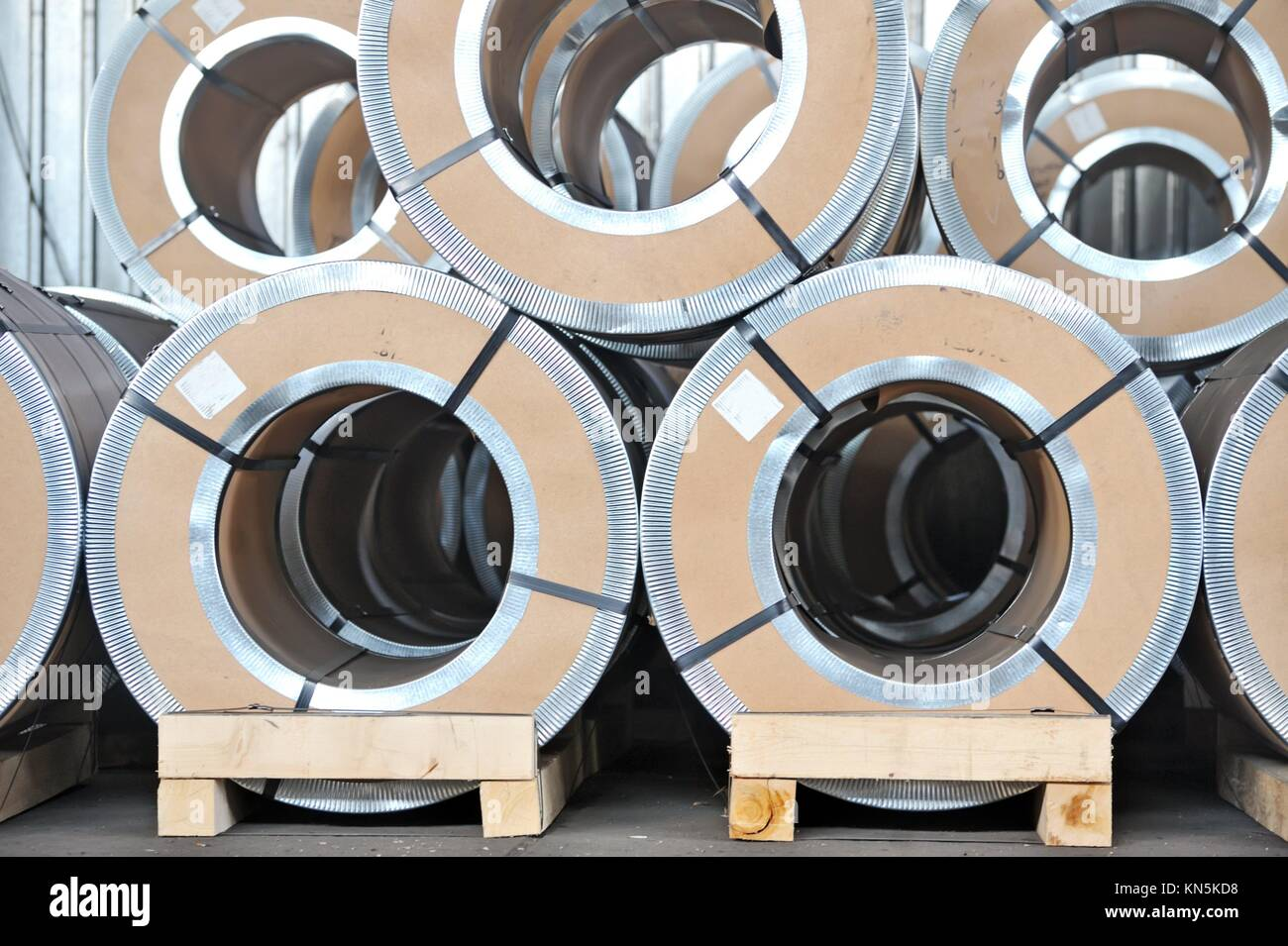packed rolls of steel sheet. - Stock Image