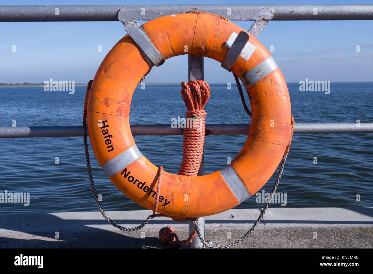 lifebelt at harbor of norderney. Stock Photo