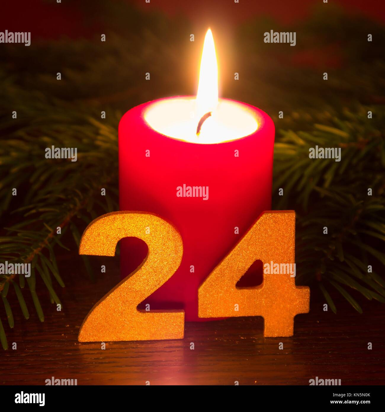 24 december, red candle. - Stock Image