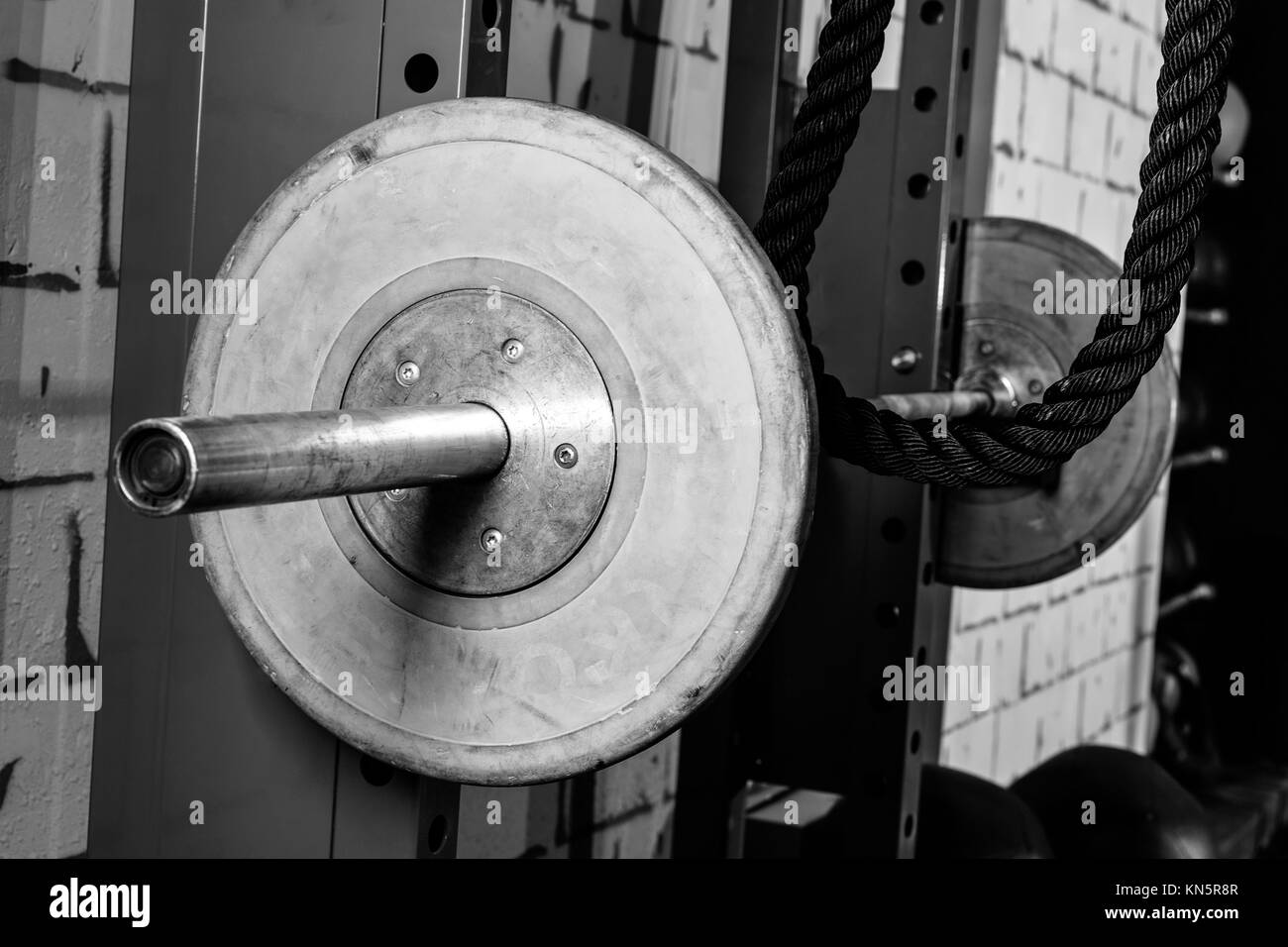 Barbells in a gym bar bells and rope at cross fit. - Stock Image