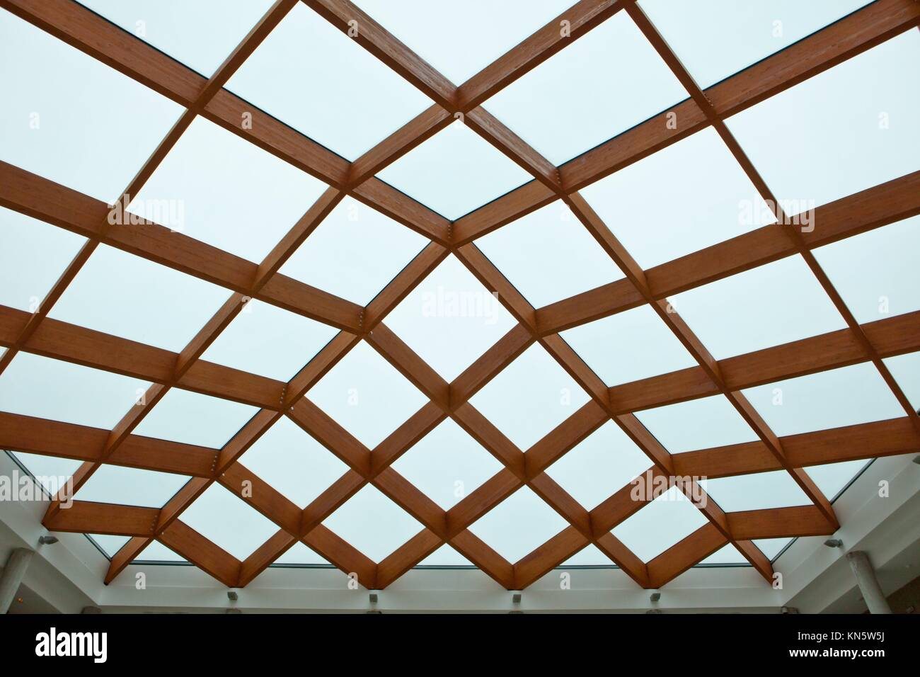 Sun-room patio area with transparent wooden ceiling. Stock Photo