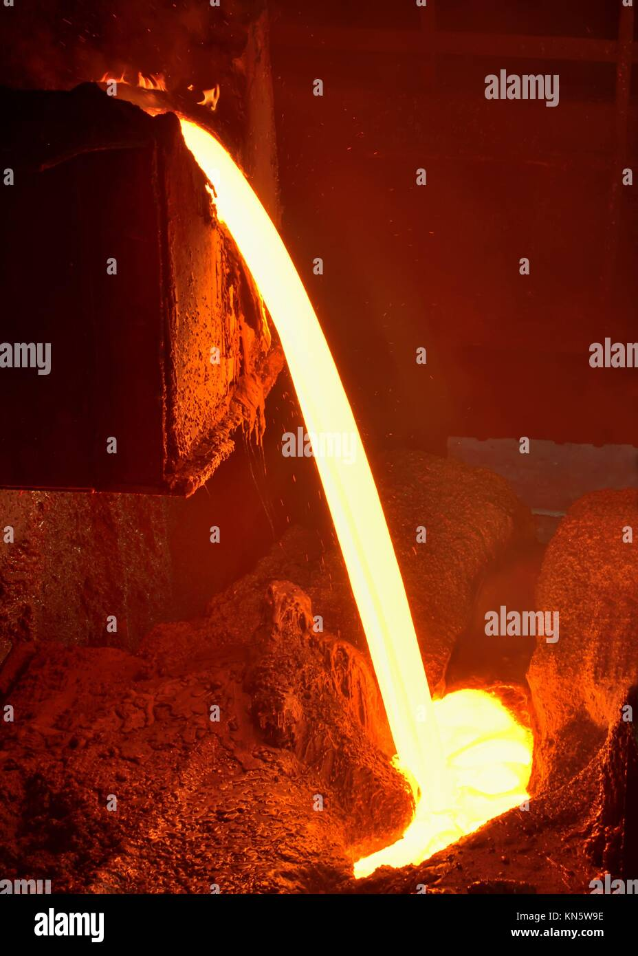 Pouring of liquid metal in open hearth workshop of the metallurgical plant. - Stock Image