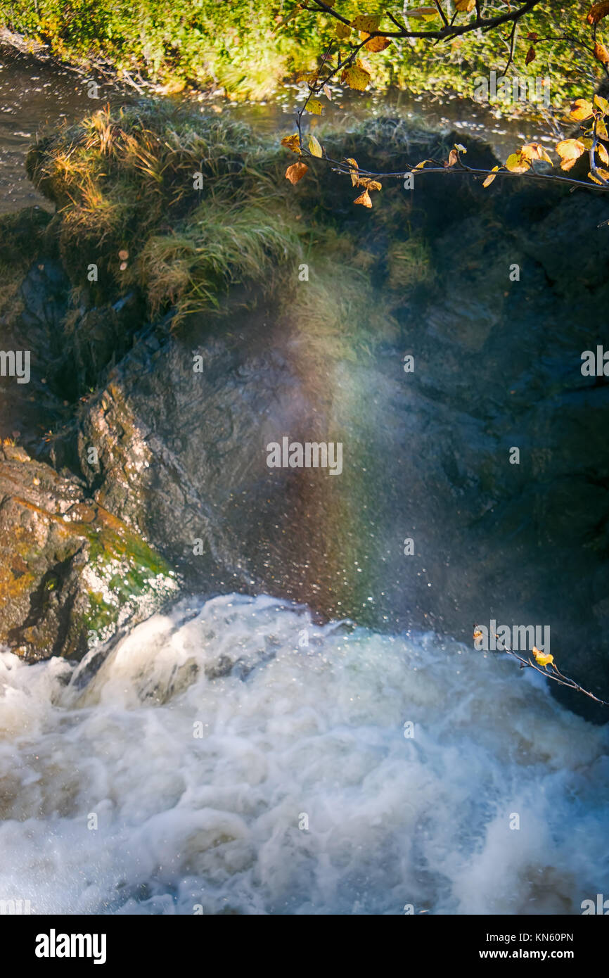 Spray of waterfall to form rainbows, rainbow palette, bright picture, beauty of rafting - Stock Image