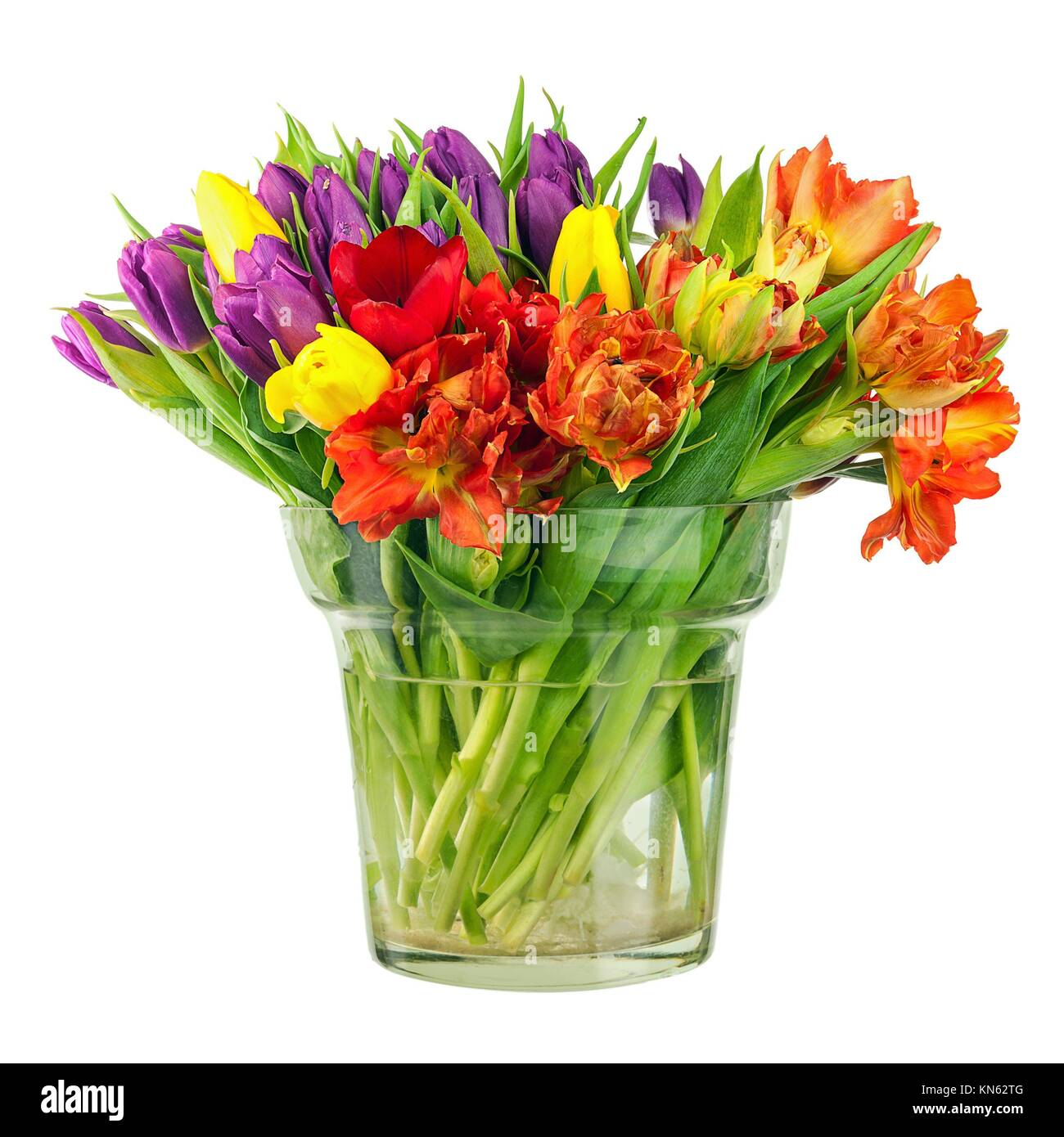 Flower bouquet from colorful tulips in glass vase isolated on white ...