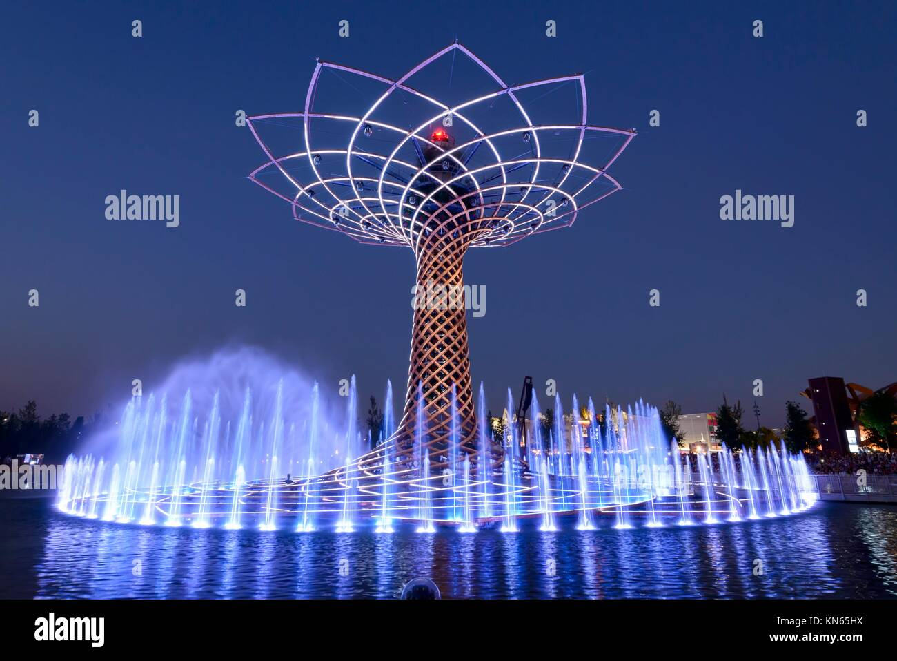 MILAN, ITALY - jun 30: EXPO 2015, night view of white beams and gushes at the lights show on the fair symbol structure - Stock Image