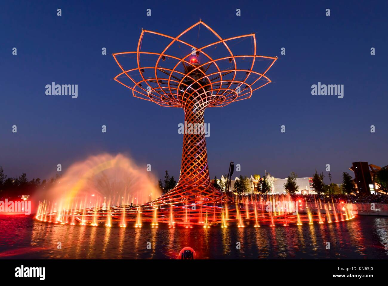 MILAN, ITALY - jun 30: EXPO 2015, night view of red colored gushes at the lights show on the fair symbol structure - Stock Image