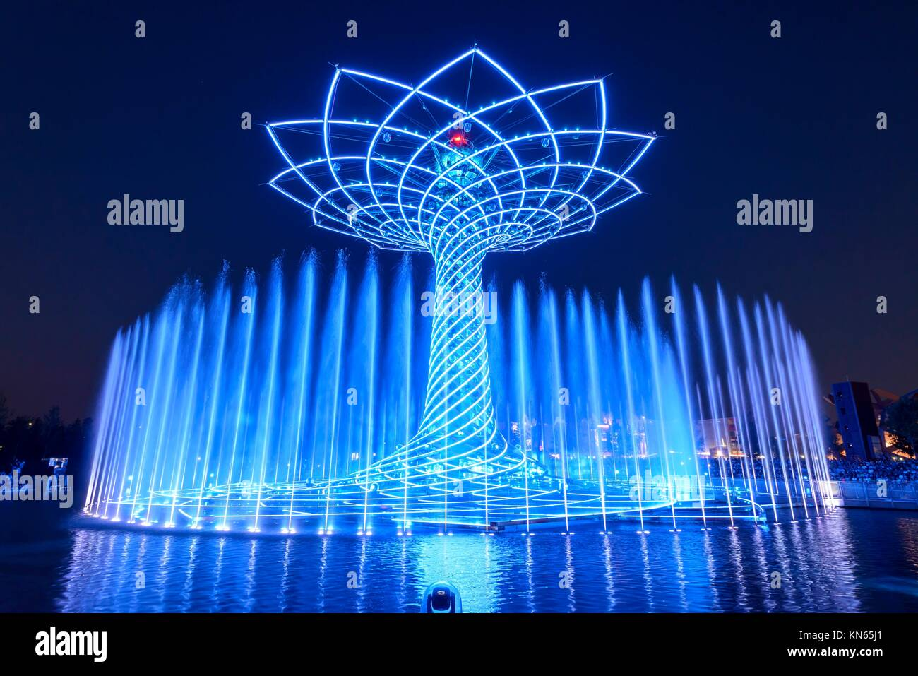 MILAN, ITALY - jun 30: EXPO 2015, night view of lights and blue colored high gushes at the lights show on the fair - Stock Image