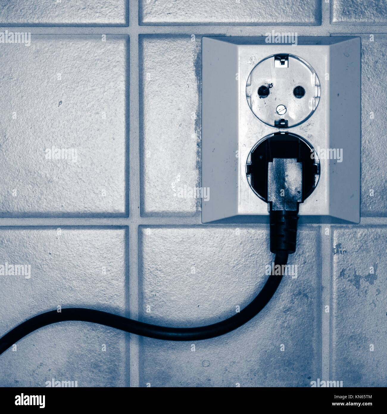 Power Cable Plugged Wall Stock Photos & Power Cable Plugged Wall ...