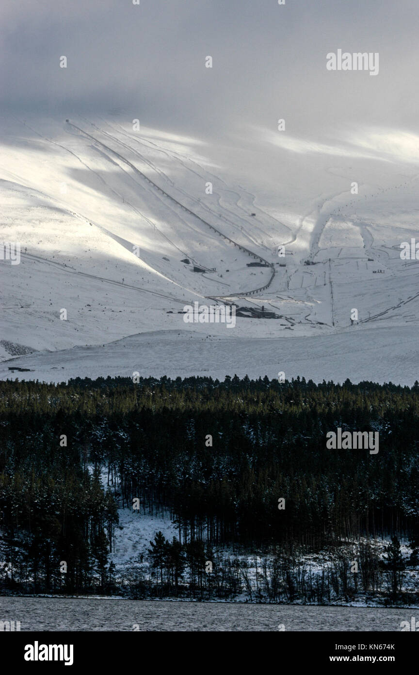 Snow covered Glenmore Forest Park and the  the Avieomore ski centre on the slopes of the Cairngorm mountains near Stock Photo
