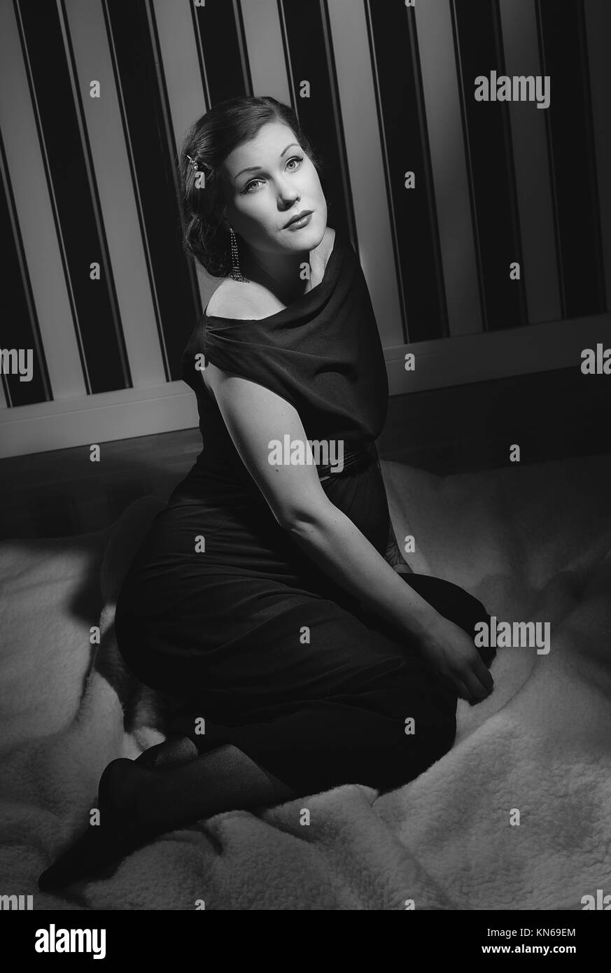 Hollywood black and white, a beautiful pregnant woman - minimal lighting and strong contrast. - Stock Image