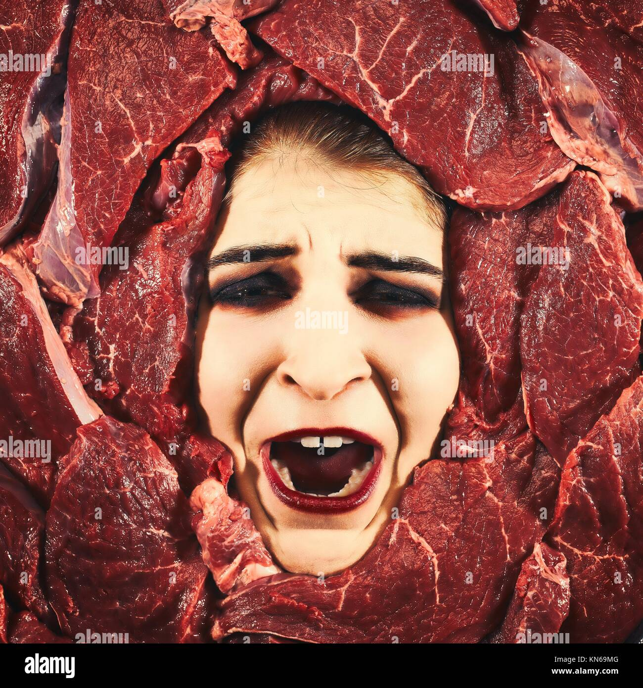 Beautiful woman expression face with beef frame, cross-processed image. - Stock Image