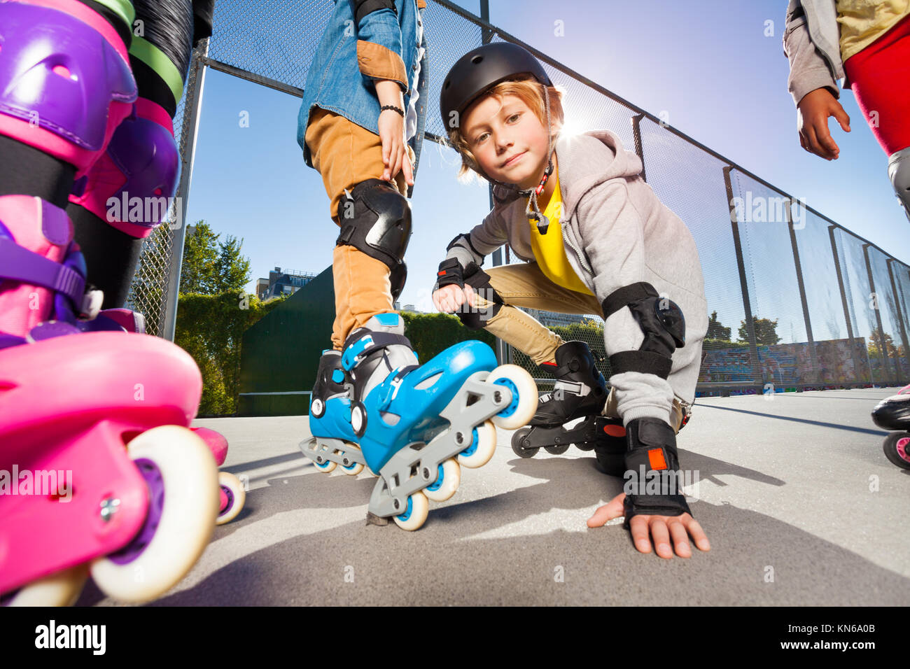 Preteen boy on roller skates at outdoor stadium at sunny day - Stock Image