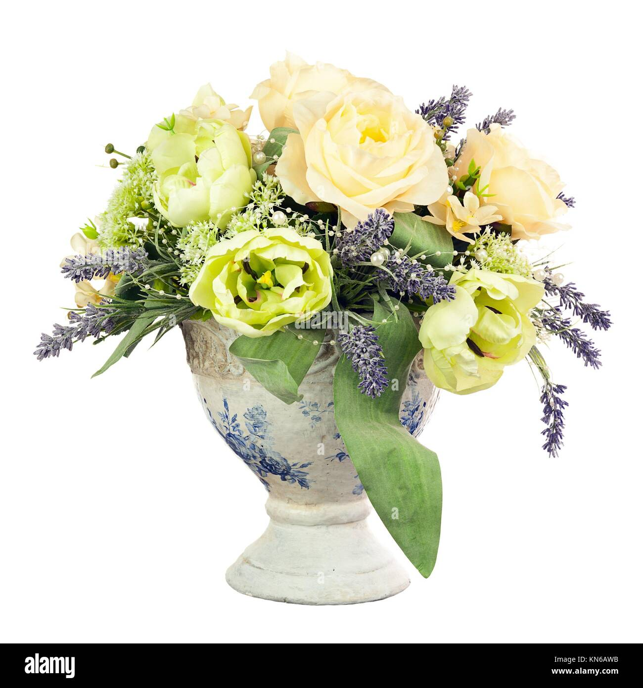 Bouquet from artificial flowers arrangement centerpiece in old vase isolated on white background. Stock Photo