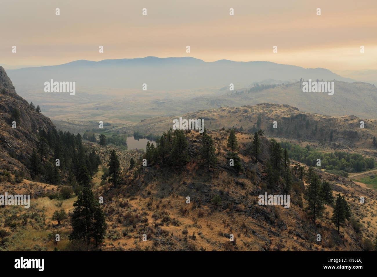 View of wild Fires smoke over Osoyoos lake, Osoyoos town, Okanagan valley, British Columbia, Canada. - Stock Image