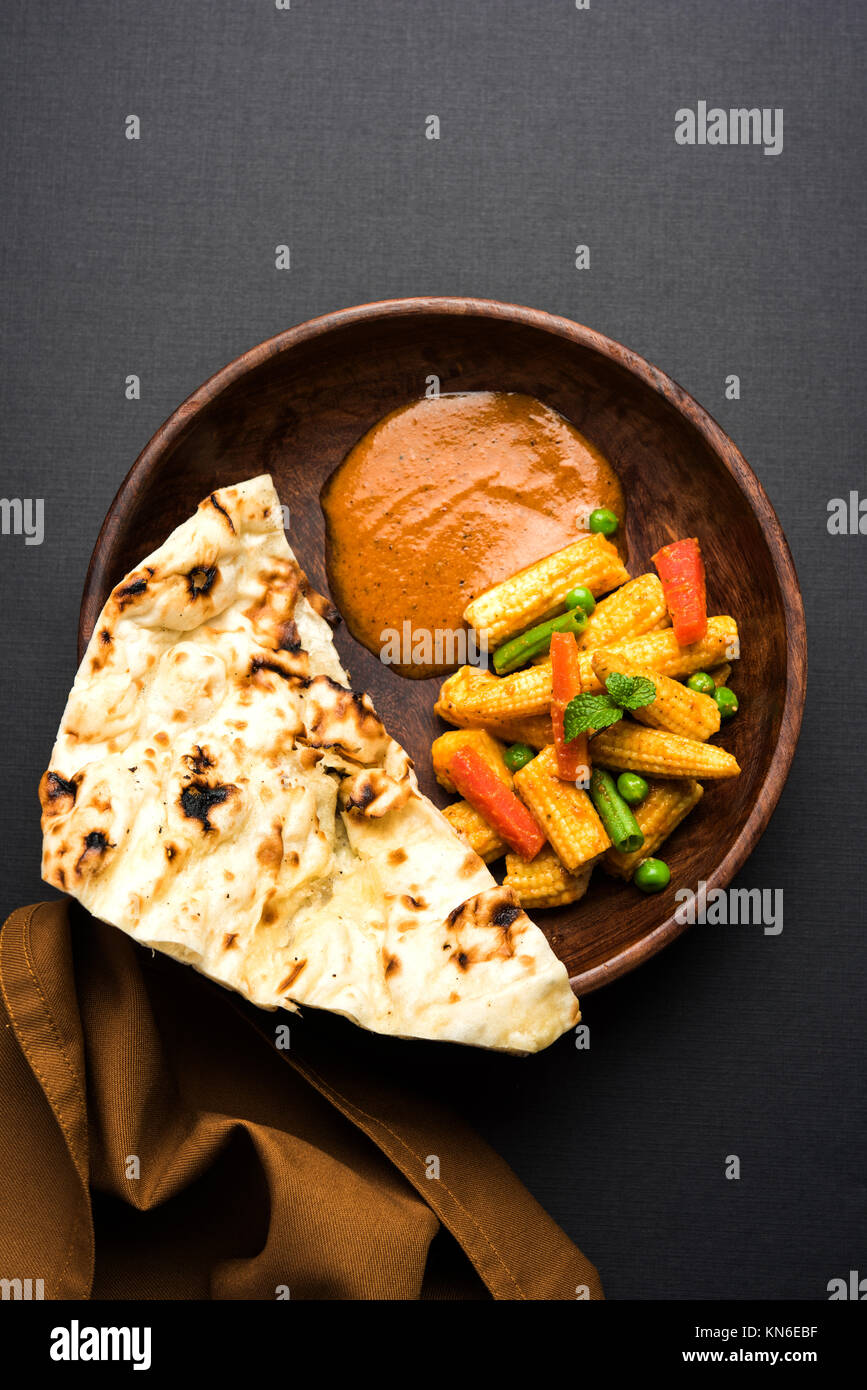 Indian Baby Corn Masala or spicy Baby corn curry served with roti or naan or indian bread - Stock Image