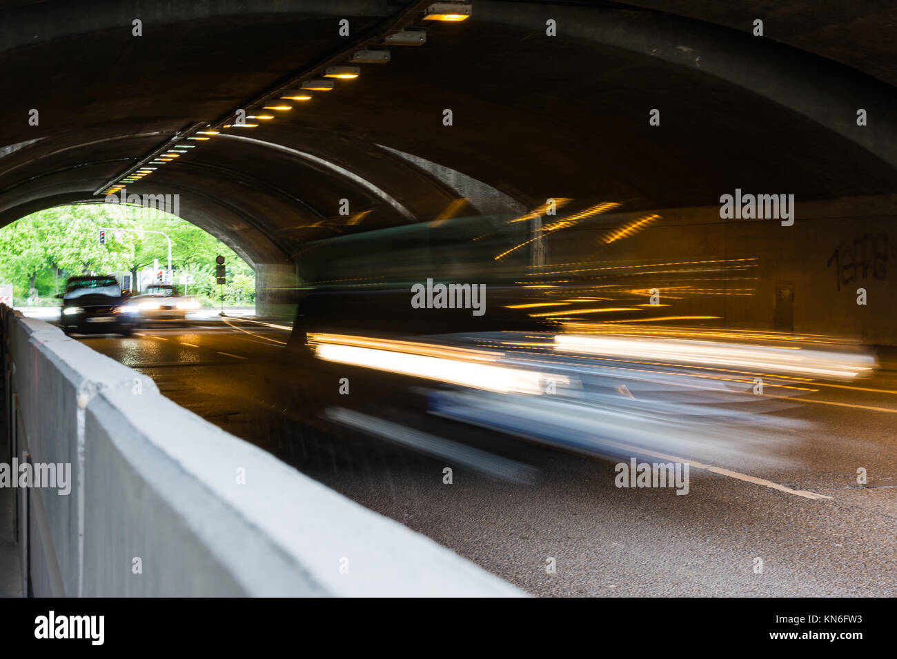 Cars Headlights Blurring through Underpass Daytime Motion City Urban Transportation - Stock Image