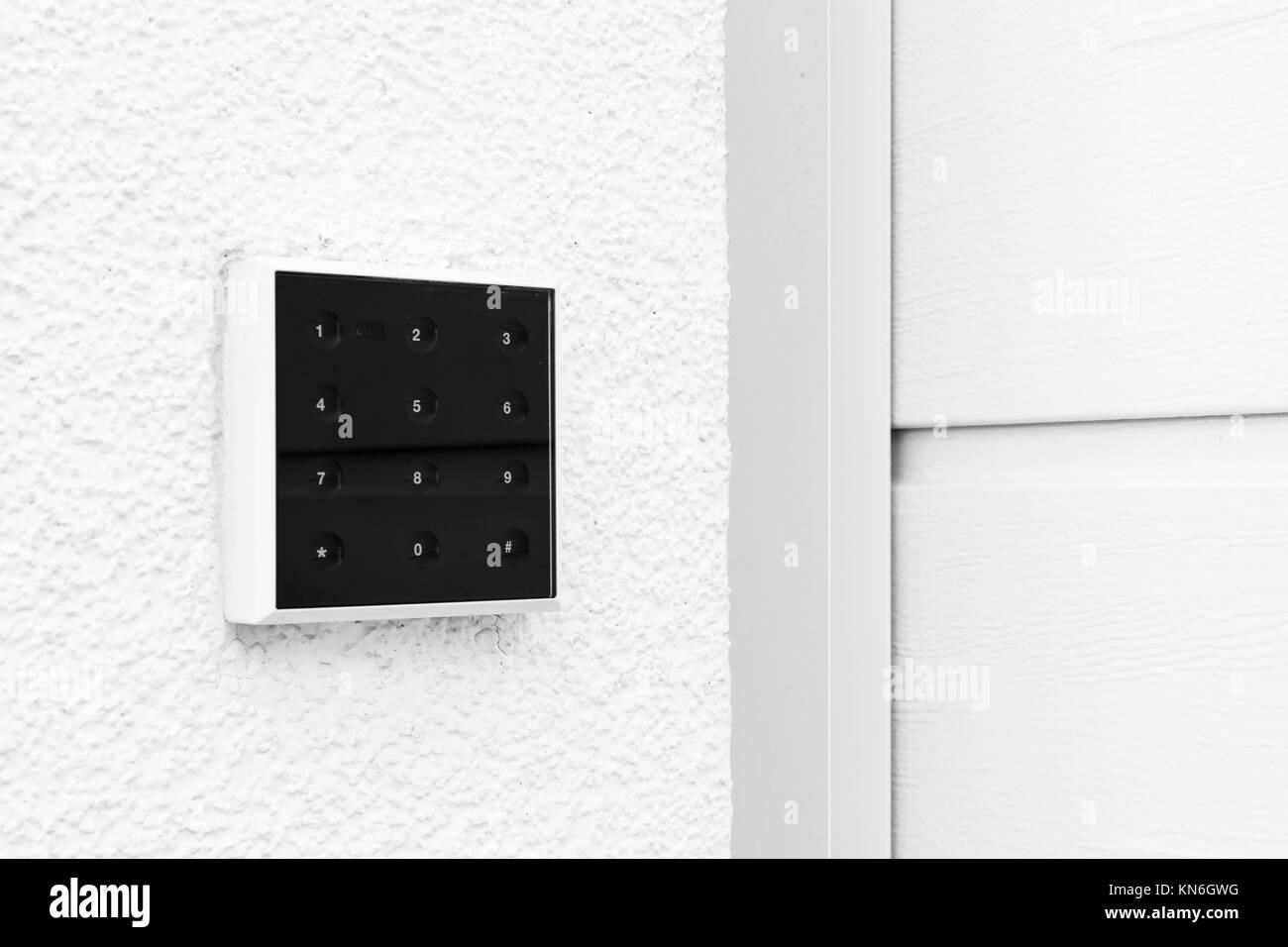 Black and White Modern Contemporary Keypad Design Garage Door - Stock Image