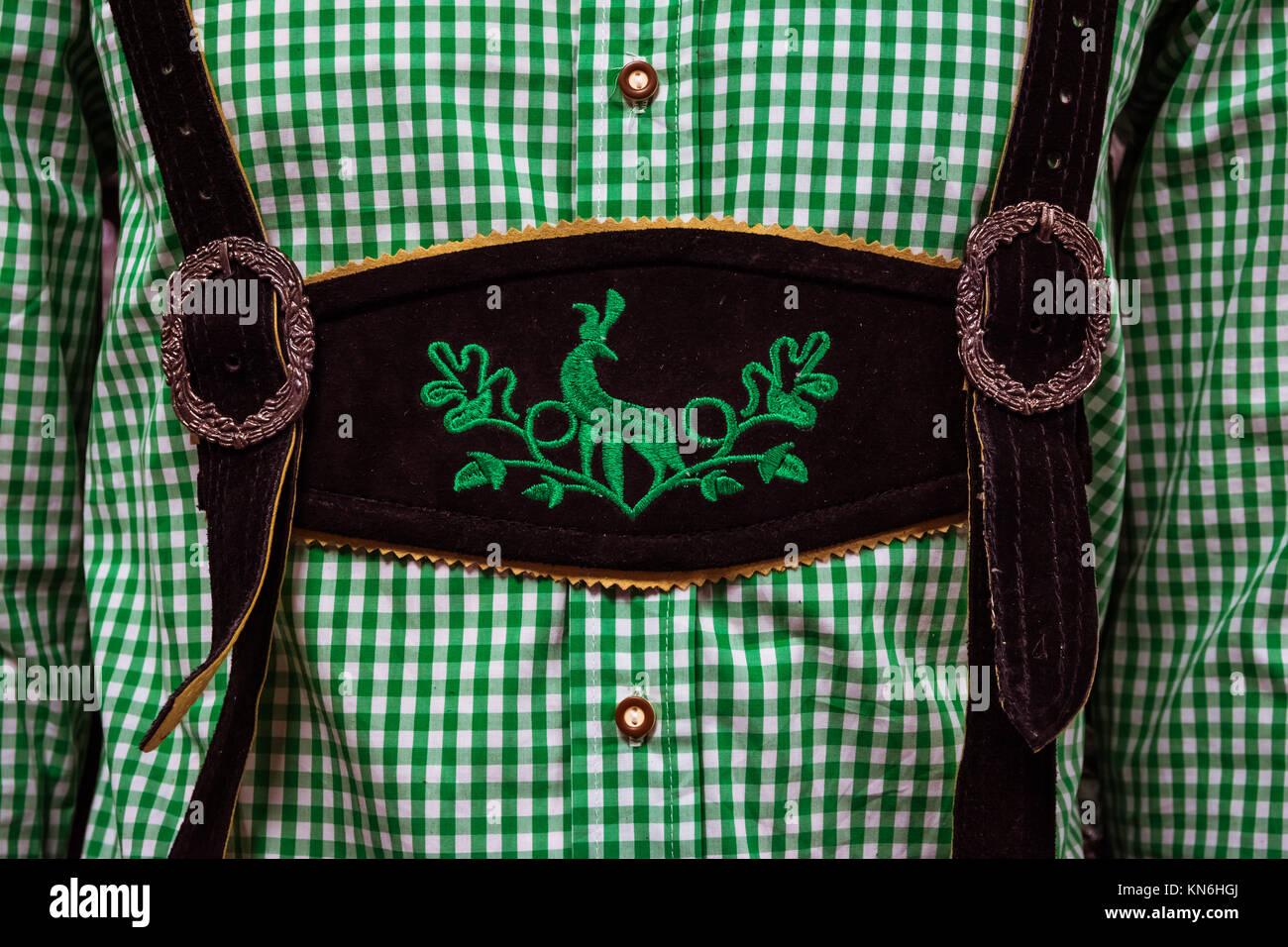 Traditional German Lederhosen Center Chestpiece Closeup Leather Plaid Dress Green White - Stock Image