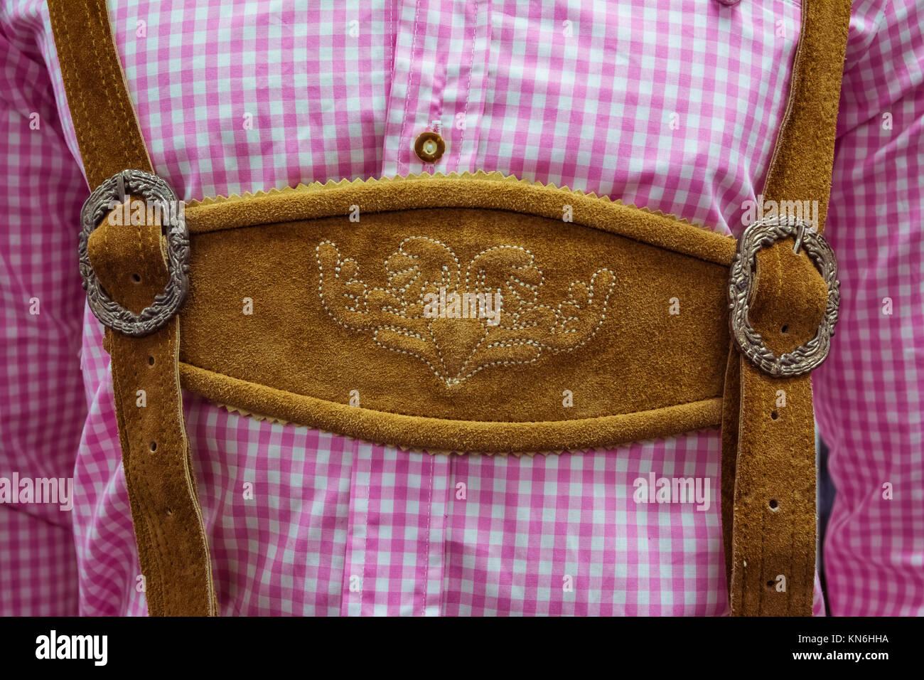 Traditional German Lederhosen Center Chestpiece Closeup Leather Plaid Dress Pink White - Stock Image